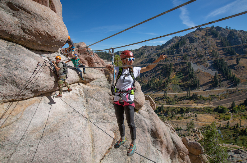 Climbers on the cable bridge on the Tahoe Via Ferrata