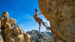 adrian ballinger on the monkey in the middle bridge on the Tahoe Via Ferrata