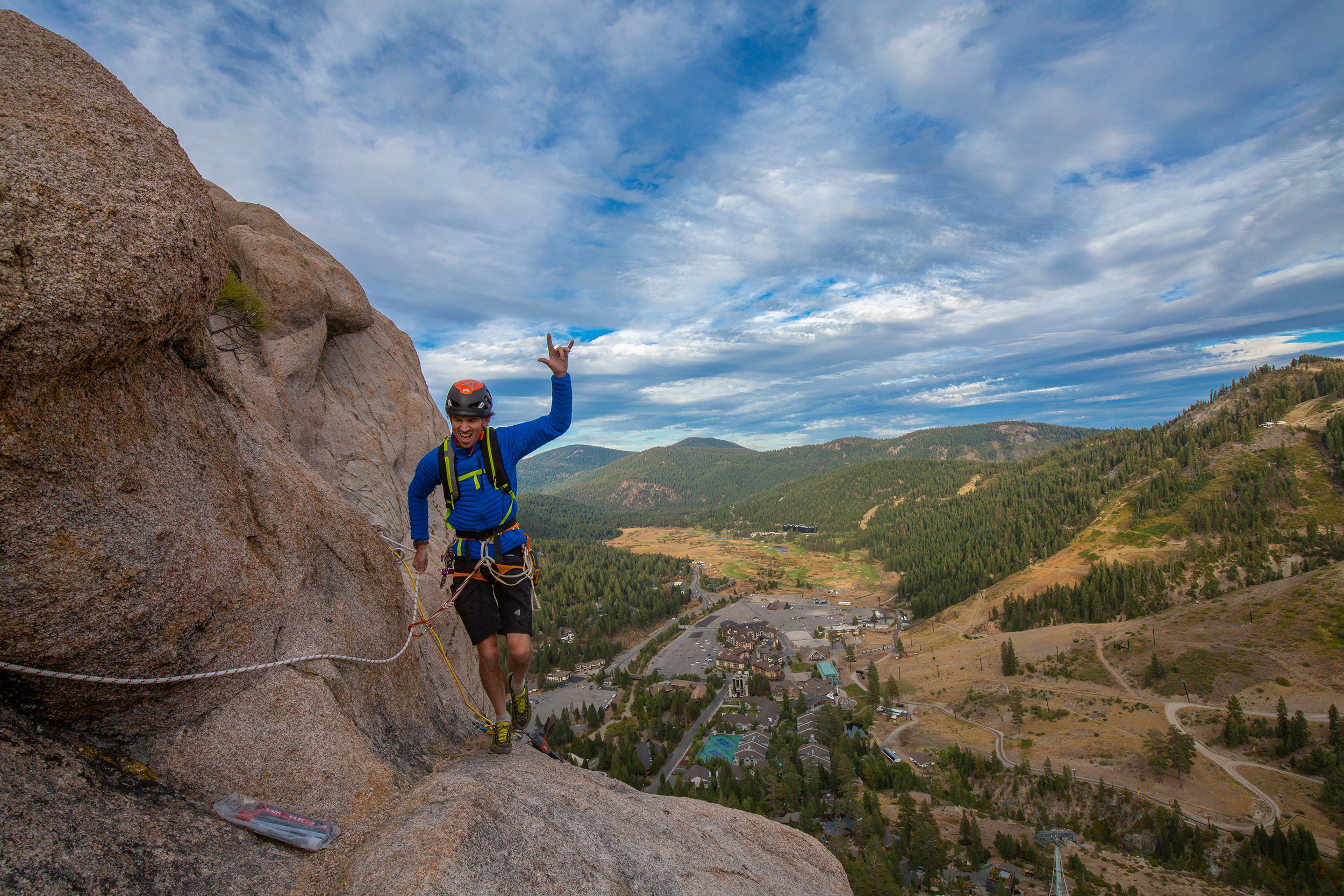 Adrian Ballinger climbing the Tahoe Via Ferrata with views of Squaw Valley