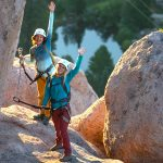 Two climbers waving hello on the Tahoe Via Ferrata